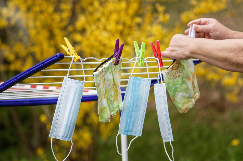 Covid face masks on washing line